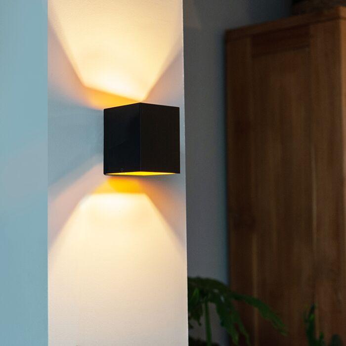 Design-wandlamp-zwart-en-goud---Sola